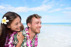 Beach couple having fun piggybacking Hawaii travel Royalty Free Stock Images