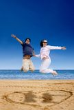 Beach couple jumping of joy Royalty Free Stock Photography