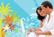 Beach couple with laptop Royalty Free Stock Photo