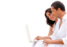 Beach couple on a laptop Royalty Free Stock Image