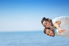 Beach couple laughing in love romance on travel honeymoon vacation Royalty Free Stock Photo