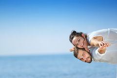 Beach couple laughing in love romance on travel honeymoon vacation Stock Photos