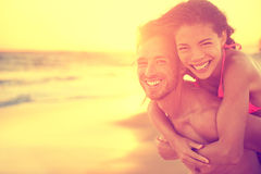 Beach couple in love having fun on honeymoon Royalty Free Stock Image