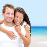 Beach couple lovers on romantic travel in love Stock Photography