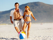 Beach couple playing with ball Royalty Free Stock Image