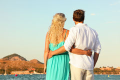 Beach couple romantic at sunset Royalty Free Stock Photos