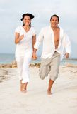 Beach couple running Stock Images