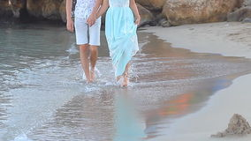 Beach couple walking on romantic travel honeymoon. Vacation summer holidays romance. Young happy lovers, Asian woman and Caucasian man holding hands embracing stock video