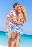 Beach couple walking on romantic travel honeymoon vacation summer Royalty Free Stock Image