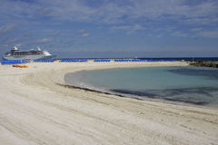 Beach cove with cruise ship. Cruise ship in background of beach cove Stock Photos