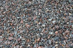 a beach that is covered in pebbles royalty free stock photography