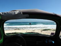The beach trough the windshield of the cabriolet. Stock Photo