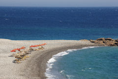 Beach in Crete with sunbeds and the Lybian sea Royalty Free Stock Photos
