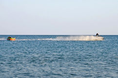 The beach in the Crimea - jetski carries tourists Royalty Free Stock Photos