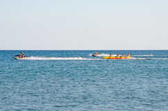 The beach in the Crimea - jetski carries tourists Stock Photo