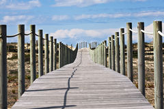Beach crosswalk. Deck crosswalk on the beach Royalty Free Stock Image
