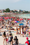 Beach Crowded With People Stock Images