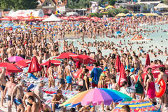 Beach Crowded With People. COSTINESTI, ROMANIA - JULY 30, 2014: Costinesti Beach Crowded With People At The Black Sea Royalty Free Stock Photography