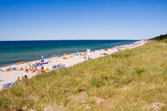 Beach crowded with tourists Royalty Free Stock Images