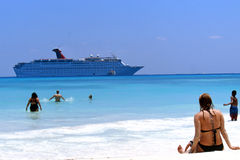 Beach and Cruise Ship. A babe on the beach