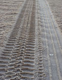 Beach Cruising. Tire tracks over wind blown sand at the ocean Stock Image