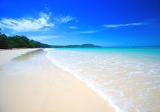 Beach with crystal clear blue waters Royalty Free Stock Images