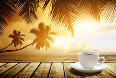 Beach and cup of coffee Royalty Free Stock Images