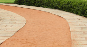 Beach curve path. Curve stone and sand path with trees in the beach royalty free stock image