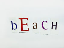 Beach - Cutout Words Collage Of Mixed Magazine Letters with White Background. Caption composed with letters torn from magazines with White Background Royalty Free Stock Images