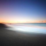 Beach dark sand and sea on morning. Tuscany Italy Royalty Free Stock Image