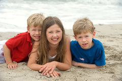 Beach day. Adorable happy kids at the beach Stock Image