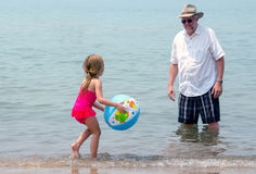 Beach day play child and grandpa Royalty Free Stock Photos