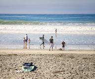 Beach Day, San Diego County, California. People--men, children, woman, girl, boys, families--enjoy different activities on the sand and in the water at the beach royalty free stock images