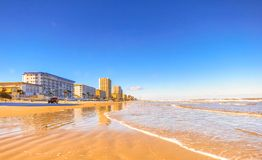 The beach of DaytonaBeach,Florida. Photo taken during a trip in 2016. The sea was going up slowly Stock Photo