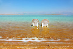 Beach on the Dead Sea, a sunny day in May Stock Photos