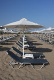 Beach with deck chairs in Rethymnon, Crete Royalty Free Stock Photo