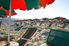 Beach. With deck chairs and umbrella in south Italy royalty free stock photography