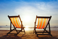 Beach deck chairs Stock Photos