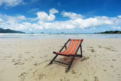 Beach with deckchair Stock Photos