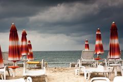 Beach with deckchairs and parasols sea Stock Photo