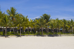 Beach. Deserted island with white sand beach and bungalows Stock Photos