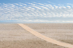 Beach diagonal wood path on sand Royalty Free Stock Images