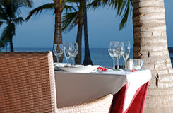 Beach Dinner. Image of a romantic dinner set up on the beach Stock Photo