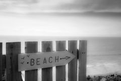 Beach direction sign - wooden, sea / sky in bg Stock Photography