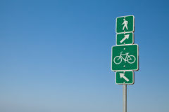 Beach directional bike path and walking sign. Long Beach, California. Beach direction where to ride your bicycle and which path to walk, run or jog on. Arrows Royalty Free Stock Photos