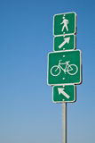 Beach directional bike path and walking sign. Long Beach, California. Beach direction where to ride your bicycle and which path to walk, run or jog on. Arrows Stock Images
