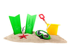 Beach with diving tools and toys Stock Images