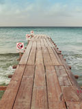 Beach dock with signals. No swimming. Vertical Royalty Free Stock Photo