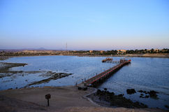 Beach and dock by sunrise stock photo