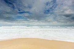 Beach with dramatic sky Royalty Free Stock Photos